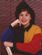 Mushroom hairstyle, color block silk top, neon background. Yes, indeed it's 1992!