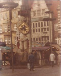 Roland surrounded by Christmas season decorations. From 1988 visit to Kriskringlemarkt.