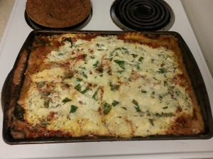 Eggplant lasagna! Sliced eggplant, thick cut, sauteed in EVOO/garlic/pepper; sauce of malbec, diced tomato, sauteed onion, chopped garlic, oil; ricotta/cottage/mozzarella cheeses mixed with chopped spinach and bound by one egg. To make completely vegetarian, no egg.