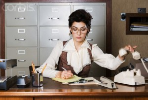 Busy Secretary Working in Office