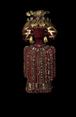 The headdress and beaded necklaces were found on the mummy of Queen Puabi, reassembled in her likeness